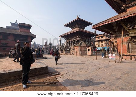 Kathmandu,nepal -5 Jan : Undentified Man Use Mobile In Tourist Attraction Patan Durbar Square In Nap