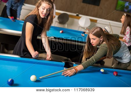Pool game. group of friends playing pool together.