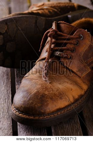 Old Worn Laces On Brown Leather Boots