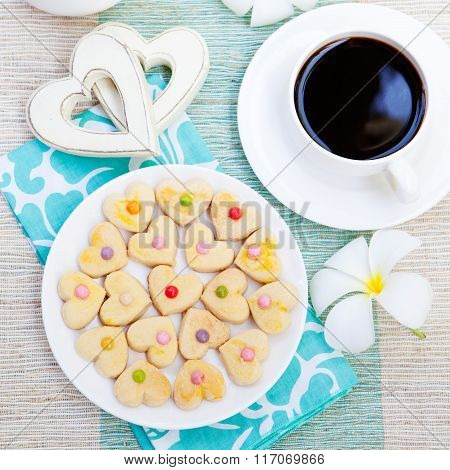 Romantic breakfast concept Cup of coffee with sugar icing decorated heart shaped cookies. Cheerful r