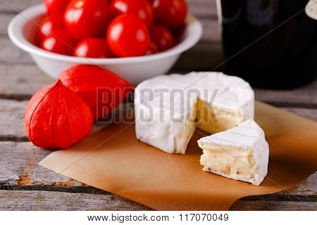 Small Portion Of Camembert Cheese In Front Of The Rest