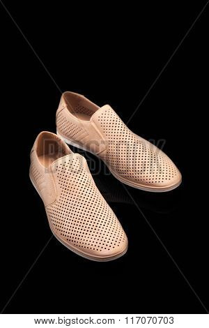 men beige summer shoes on a black background