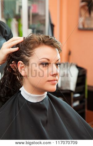 in a hairdressing salon girl doing hairstyle. beauty