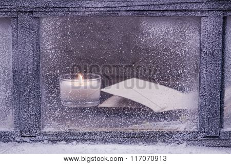 Frosted Winter Window. One Light Candle