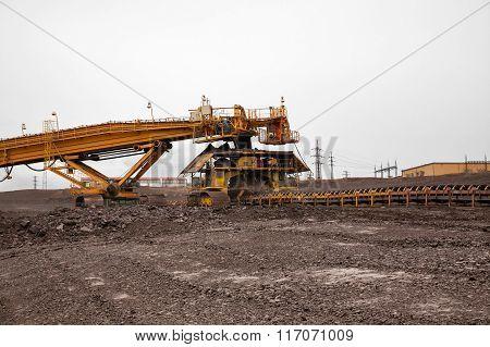 Huge coal loading conveyor belt piles coal