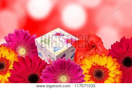 Gift box and colorful flowers with blur bokeh background