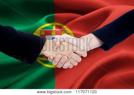 Agreement Handshake With Flag Of Portugal