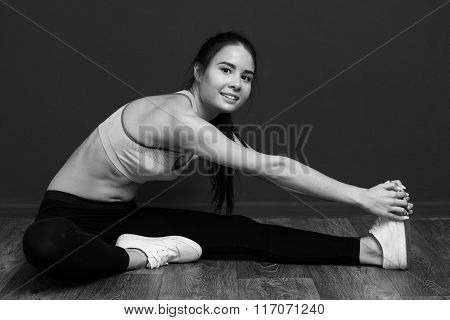 Fitness Woman Smiling At The Camera And Doing Stretching Hamstring.