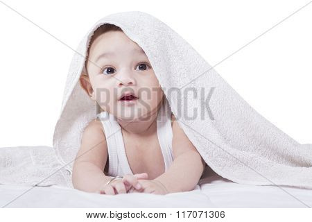 Baby Crawling Under A Towel