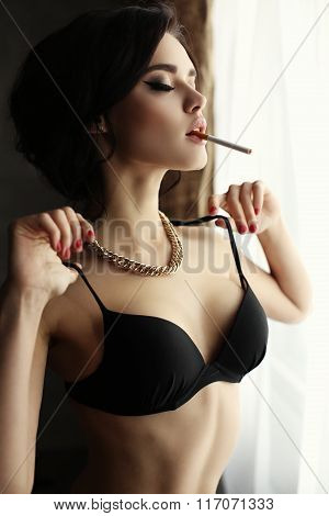 Beautiful Sexy Girl With Dark Hair Wears Lingerie,smoking Beside A Window