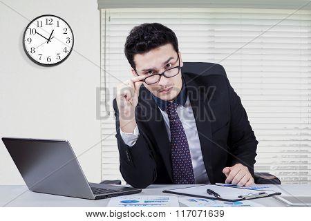 Caucasian Manager Staring At Camera