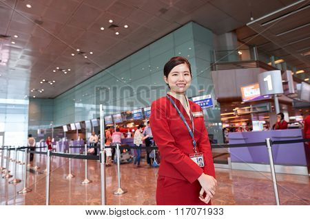 SINGAPORE - NOVEMBER 04, 2015: Cathay Pacific staff at Changi Airport. Singapore Changi Airport, is the primary civilian airport for Singapore.