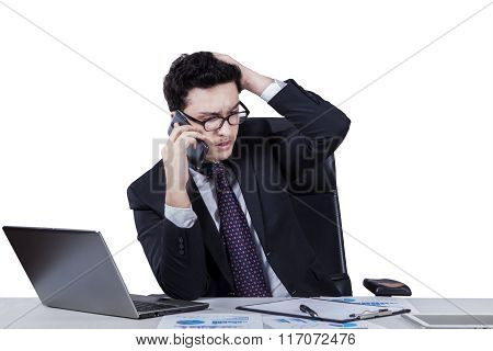 Frustrated Caucasian Worker Talking On Cellphone