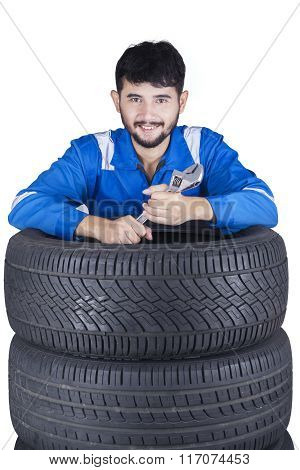 Mechanic With Wrench And Tires