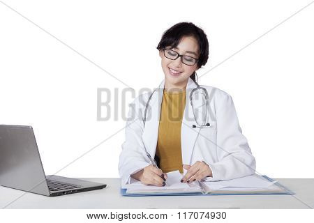 Pretty Doctor Writes On The Paper