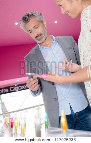 man at e-cigarette store