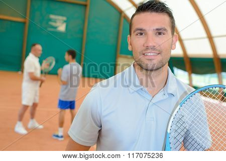 man in the tennis court