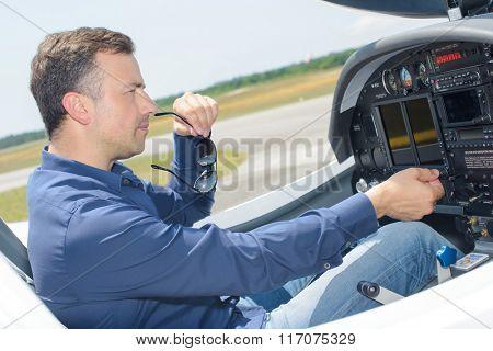 Man operating light aircraft
