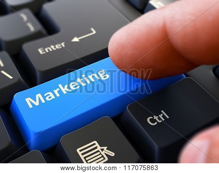 Marketing - Concept on Blue Keyboard Button.