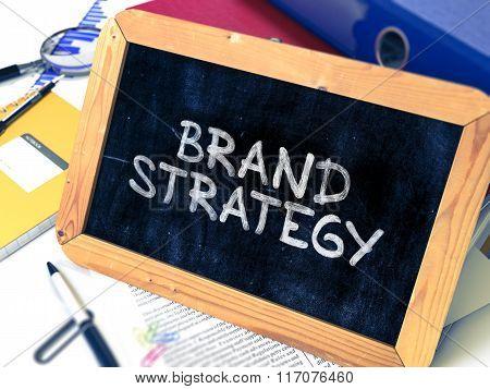 Brand Strategy Handwritten by White Chalk on a Blackboard.