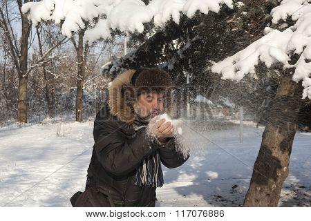 Man Blowing On Snow