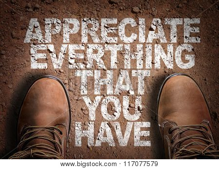 Top View of Boot on the trail with the text: Appreciate Everything That You Have