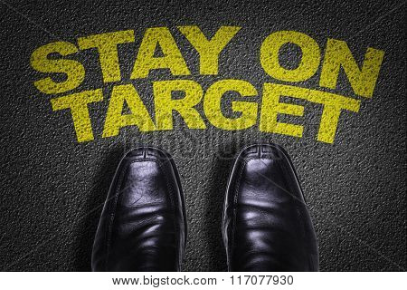 Top View of Business Shoes on the floor with the text: Stay on Target