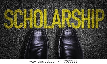 Top View of Business Shoes on the floor with the text: Scholarship