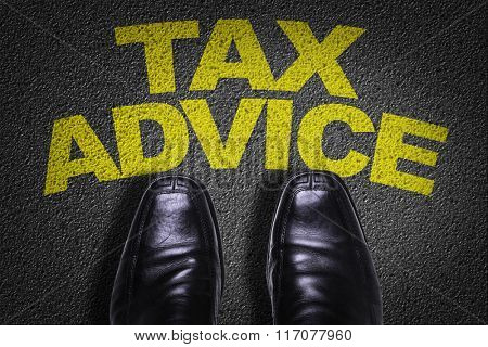 Top View of Business Shoes on the floor with the text: Tax Advice