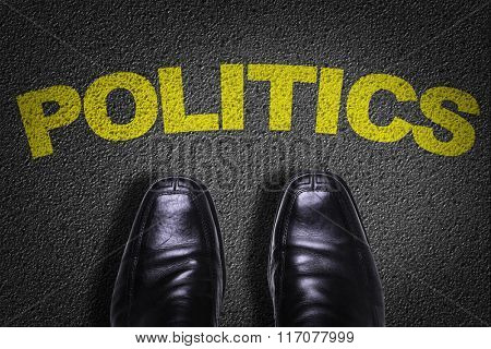 Top View of Business Shoes on the floor with the text: Politics