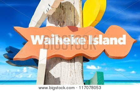 Waiheke Island welcome sign with beach