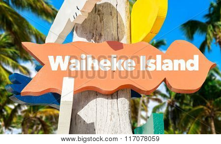 Waiheke Island welcome sign with palm trees