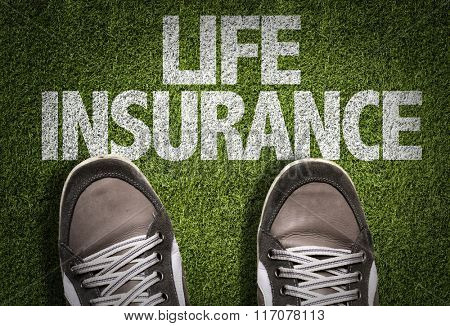 Top View of Sneakers on the grass with the text: Life Insurance
