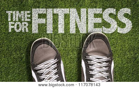 Top View of Sneakers on the grass with the text: Time for Fitness
