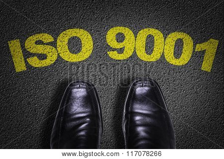 Top View of Business Shoes on the floor with the text: ISO 9001