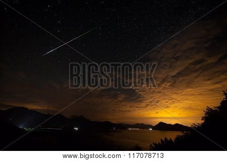 Some stars in the night with beautiful mountain at the Podgorica