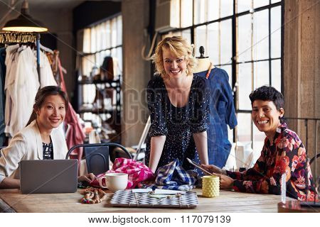 Portrait Of Three Fashion Designers In Meeting