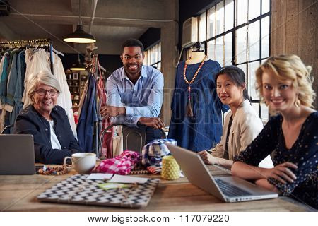 Portrait Of Four Fashion Designers In Meeting