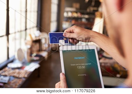 Credit Card Reading Device Attached To Digital Tablet