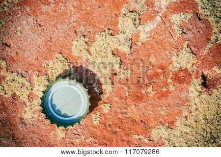 Background Or Texture Of Red Brick And Bottle Cap.