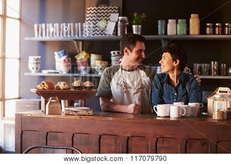 Couple Running Coffee Shop Behind Counter