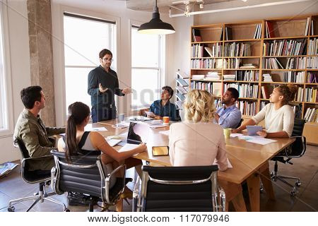 Businessman Addressing Team Meeting Around Table