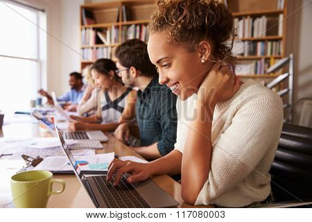 Business Team Having Meeting In Busy Office