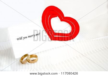 A Note, Wedding Rings And A Red Heart