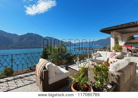 Architecture, nice terrace of a villa, lake view