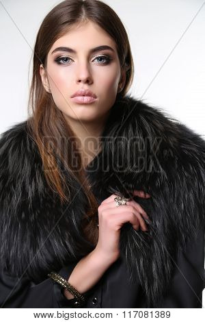 Beautiful Woman With Dark Straight Hair Wears Elegant Clothes And Bijou