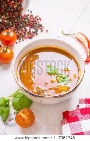 Tomato Soup With Meat In A White Bowl On A White Wooden Background