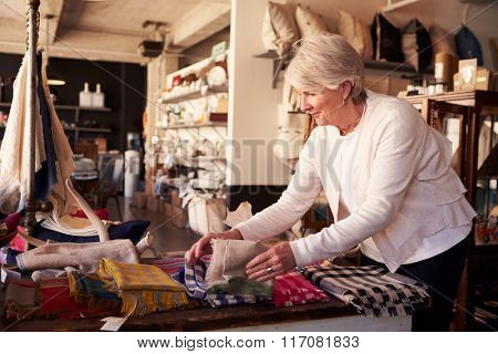 Senior Female Working In Gift Store