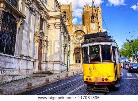 Historical Yellow Tram In Front Of The Lisbon Cathedral, Lisbon, Portugal