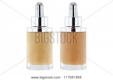 Glass Bottles of liquid foundation with dropper in pink and yellow undertone isolated on white